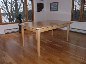 Solid Maple Dining room Table with extendable leaves